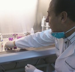 Dr. Pena working in biocabinet